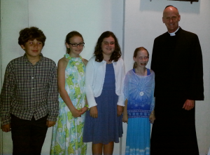 Haagen Williams, Dani Andersen, Currie Marchant, and Ella Grace Sines Thomasson (not pictured Jameson Hoffman) celebrated their First Communion